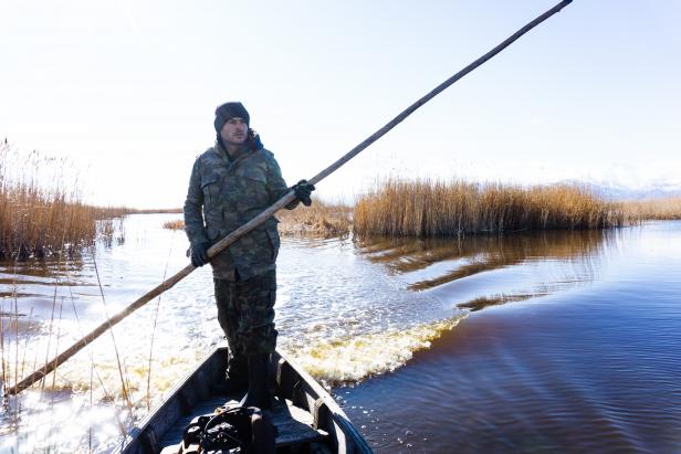 Poling the Boat on Eber Lake Blog